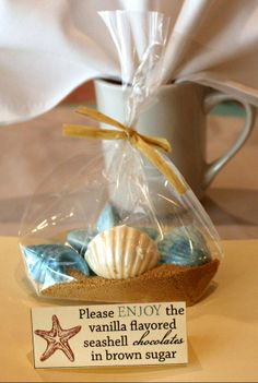 Bridal Shower, beach theme, 5/17/14: Guest favors. Handmade chocolates in light brown pure cane sugar. Personally designed individual table signs.