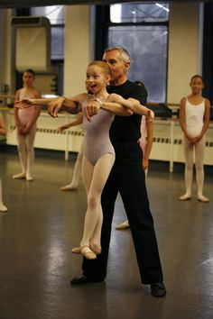 The joy of dance. (Shown here is curriculum creator and Principal of the Jacqueline Kennedy Onassis School, Franco De Vita and a happy student.) If there's any way to teach a dancer how not to have noodle arms, I'd say that's it.