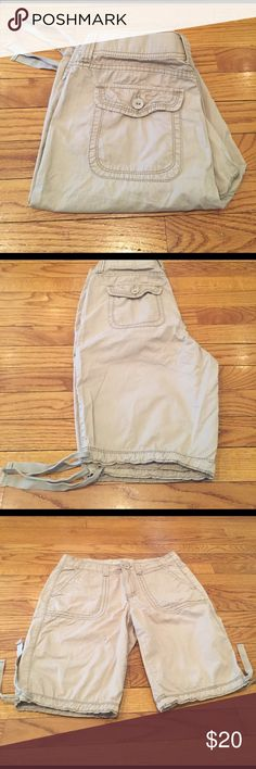 Tan shorts Tan shorts from St. John's Bay. 32 inch waist 9 1/2 inch rise. 10 1/2 inch inseam. Length is 20 inches. Leg opening 18 inches. Two front slide pockets to back button pockets belt loop. 100% cotton. Shorts