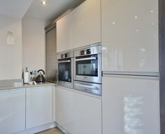 Eye level BOSCH appliances included in the bank of towers. Designed, Supplied and Installed by KITCHENCRAFT Essex.