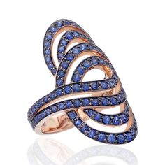 Infinitas blue sapphire cocktail ring in rose gold by Lily Gabriella. This abstract statement ring design is set with 3.2 carats of blue sapphires. Discover Lily Gabriella's fashionable and versatile jewels for fashion forward ladies: http://www.thejewelleryeditor.com/jewellery/article/lily-gabriella-pop-up-shop-harvey-nichols/ #jewelry