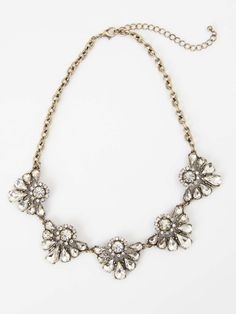 You will glisten when you wear this fancy floral necklace!