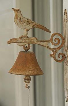 rustic dinner bell ~ I have this same bird bell ringer hanging beside my front door. Ring My Bell, Cedar Hill, Dinner Bell, Ding Dong, Door Knockers, Rustic Charm, Bird Houses, Decorative Bells, Wind Chimes