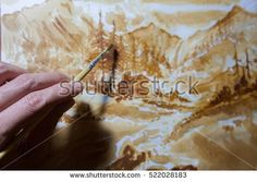 Artist painting on drawing paper with coffee powder , coffee art, coffee paint with brush