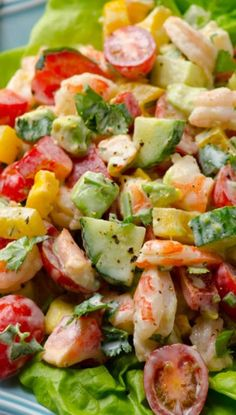 Creamy shrimp salad with avocado, tomato, cucumber, bell pepper and scrumptious Greek yogurt dressing. You won't miss mayo for a second.