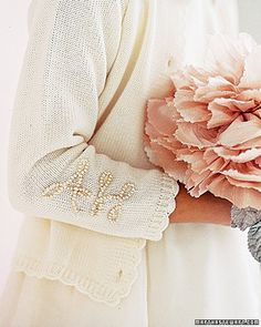 Charming+in+Marie+Chantal+cardigans+embellished+with+their+initials,+Jessica's+nieces+carry+silk+blooms.