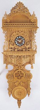 The Grand Geneva Plan is a beautiful piece of art work.  This plan is easy to scroll and build starting from the back and working forward.  One of the many great scroll saw clock plans available.