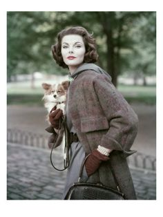 Vogue - August 1956  by Frances Mclaughlin-Gill. She wears a tweedy plaid coat over a periwinkle knit dress by Anna Willer, accented with deep rust gloves and jewelry from famed designer David Webb.