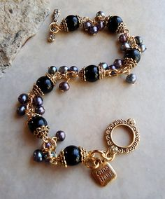 Black Onyx Cluster Bracelet.Peacock Pearl.Toggle plated in 24k
