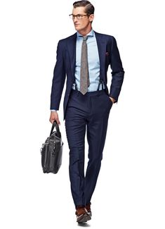 This luxurious La Spalla suit features hand-stitched detailing, narrow shoulder and a full canvas 2.5-button jacket on wool-cashmere by E.Thomas. Additionally, this blue suit comes with flat front trousers with belt loops and brace buttons. Suit Supply