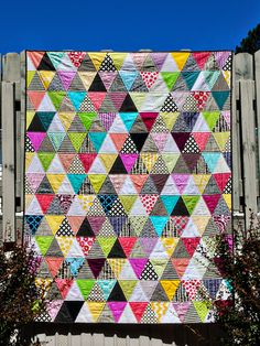 I finished my triangle quilt this weekend! I think this is my favorite quilt that I've made so far.    Tons of bright colors, alternating ...