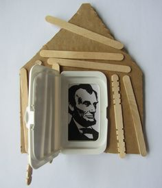 Log Cabin for Presidents' Day - cardboard, popscicle sticks, glue, scissors,  a flip top lid ( ours is from baby wipes), a picture or drawing of President Lincoln and some crayons. You could write a clue on the outside of lid and when you open it you see the President inside.