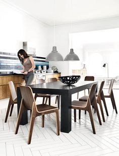 Table & Chairs BoConcept. Love the wall tiles.