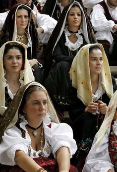 Sardinia - a festival where Girls dress up in traditional costumes.