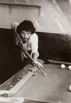 The Boss shoots pool.