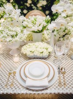 Love the checkered white and gold table cloth amidst all the white blooming florals! Photo: WedLuxe