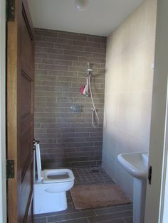 Front bath.  european shower / no door, to make tiny bathroom feel bigger