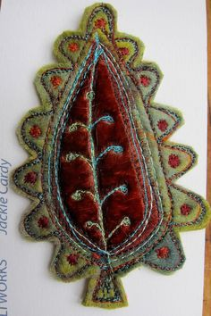 Rich deep chestnut and olive  Paisley felt brooch.