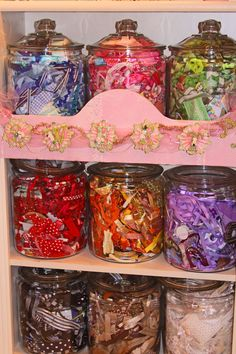 Ribbon Storage: Candy Jars!  I don't use ribbon often, but I would store little bits and bobs, color-coded in these!
