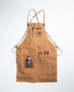 Waxed canvas and leather, simple and sturdy. Great apron made in Portland, OR.