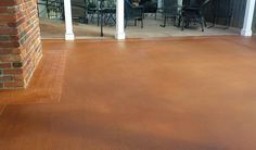 "This ""Broom Swept"" designed patio is easily achievable by resurfacing your space and adding a decorative border and stain for long lasting. #ResurfacePatio #DecorativePatio #ResurfacedConcrete"