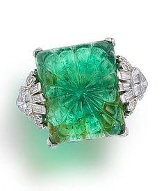 Art Deco emerald & diamond ring, ca 1925.  elegant carving of the emerald.