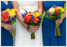 The bridesmaids here are carrying sunflowers, orange dahlias, yellow mums, delphiniums, veronicas and red hypericum berries. Blue can match against various colors like orange, yellow and red for stunning effect.