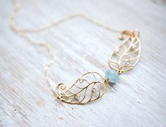 Aquamarine Organic Bead and gold plated leaves on 14k by pardes, $38.00