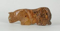 """""""Masterpiece"""" - Mountain Lion Fetish Carving (fossil jasper) Mountain Lion symbolizes grace, leadership & strength. Lion has the natural ability to lead without insisting that others follow. She teaches the ability to be true to yourself & to trust your inner knowledge & direction. Lion can impart power & self-confidence when dealing with problematic people. The Cherokee people considered Mountain Lion sacred because she has the power to see in the dark."""