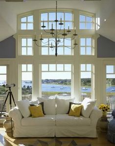 Living room with ocean view. All white, open and clean looking. I want THIS room.