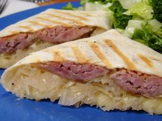 """Bratwurst Wraps With Onion-Sauerkraut Filling: """"The bratwurst was delicious. I also cooked the onions in a dark ale."""" -Lori Mama omg check these out! Wrap Recipes, New Recipes, Cooking Recipes, Favorite Recipes, Healthy Recipes, German Recipes, Grill Recipes, What's Cooking, Kitchens"""