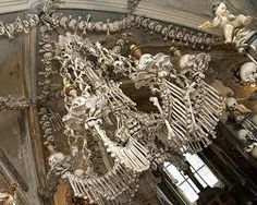 Sedlec Ossuary, Czech Republic 90 minutes out of Prague.  The basement level chapel contains 40,000 skeletons fashioned into skull candelabras, and towering coat of arms, and one seriously morbid chandelier.