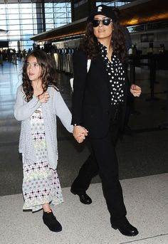 Salma Hayek in a printed button-down and black separates with daughter Valentina Pinault