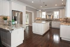Traditional Kitchen with Flat panel cabinets, Armstron Flooring 5 in. Engineered Hardwood Wide Plank Hickory, Hardwood floors