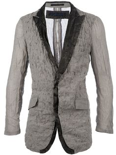 Grey cotton blazer from Kohshin Satoh featuring a notched leather lapel, a breast pocket, a concealed front button fastening two flap pockets, long sleeves with button cuffs, a central back seam detail and a distressed fabric front section.
