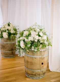 Rustic barrels accompanied by white florals and greenery