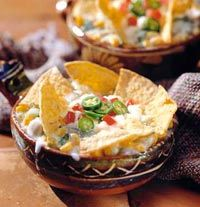 Mexican Tortilla Casseroles, with chicken, corn and cheese, in individual dishes.  Can't find Mexican cheese in your city?  Monterey Jack Cheese will work.