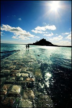 Running towards the St. Michael' Mounts, Marazion, Cornwall, England. The island is accessible by foot when the tide is out!