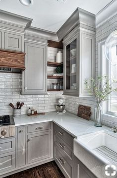 Gray cabinets white countertops wood accents
