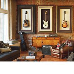 Love the idea of turning guitars into artwork for a music room. Could still take then down and play