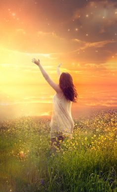 Risen, woman praising the Lord in a golden field of flowers. Prophetic art.