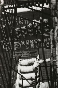 W. Eugene Smith    Untitled [neon sign through snow-covered fire escape]    New York City, 1957-58    From W. Eugene Smith: Photographs 1934-1975
