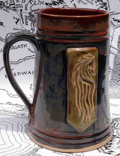 Beautiful mug of Rohan with the white horse of the banner of Rohan on the front. Riders of Rohan of Middle earth were known for their dedication