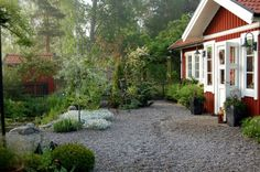 Swedish country garden with pond and containers