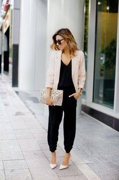 Consider pairing a nude blazer with a black jumpsuit for a standout ensemble. A cool pair of beige leather pumps is an easy way to upgrade your look. Shop this look for $157: http://lookastic.com/women/looks/sunglasses-blazer-bracelet-clutch-jumpsuit-pumps/5574 — Dark Brown Sunglasses — Beige Blazer — Silver Statement Bracelet — Beige Print Leather Clutch — Black Jumpsuit — Beige Leather Pumps