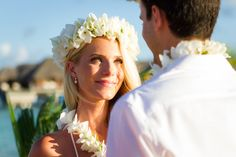 During the Polynesian wedding, the bride and groom will exchange leis and flower crows with one another. Tiare Tahiti, tipanier, and hibiscus flowers are the most traditional flowers.
