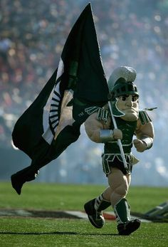 Sparty performs during the Rose Bowl Game presented by Vizio against the Stanford Cardinal at the Rose Bowl on January 2014 in Pasadena, California. (Photo by Jeff Gross/Getty Images) Msu Football, Michigan State Football, Michigan State University, College Football, Football Season, The Mitten State, Msu Spartans, Stanford Cardinal, Rose Bowl