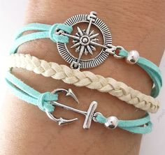 Compass and anchor bracelet.