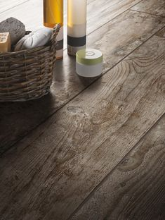 These rustic wood look tiles from the Daltile Season Wood Tile Collection in Autumn Wood will fool everyone into thinking your floor is made of reclaimed wood. Go rustic contemporary with this dark wood look tile.