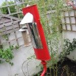 The red exhaust pipe bird feeder.